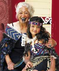 New Zealand Maori child and grandmother in traditional dress